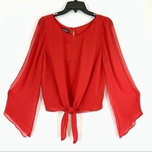 Bebe tie front, cutout sleeve blouse size L